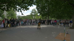 Man performing for tourists on The Queen's Walk in London Stock Footage