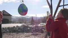 Little boys hitting a piñata at party Stock Footage