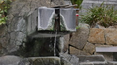 Water flows at a japanese open air hot spring .. Stock Footage