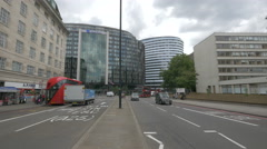 Westminster Bridge street with cars, hotel and school London - stock footage