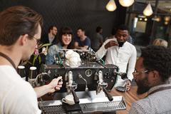 Barista training at an espresso machine in coffee shop Stock Photos