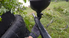 Personal Perspective Of A Paintball Player. Paintball game, first person view Stock Footage