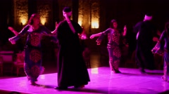 Hurghada, Egypt - February 26, 2016 A group of men and women dancing traditional Stock Footage