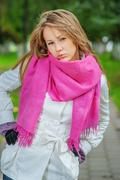 Girl with pink scarf - stock photo