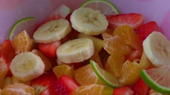 Bowl of healthy colorful fruit salad Stock Footage