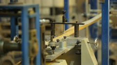 Paper rolling through an automated paper bag making and folding assembly machine Stock Footage