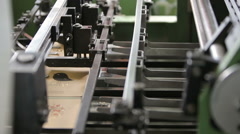 Production line at a print factory, fixing paper, close up - stock footage