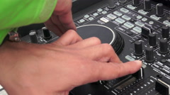 DJ scratching on the Decks at a disco Stock Footage