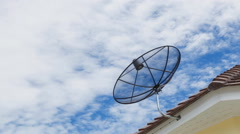 Time lapse of clouds moving above television sattelite dish.Telecomunications Stock Footage