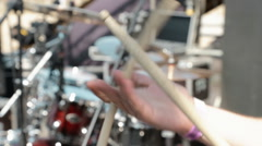 Close-Up of the Hands of the Drummer Who Spins the Drum Sticks Between His Stock Footage