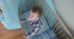 Toddler jumping up and down in his bed topview Stock Footage