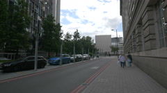 Two women with children walking on Belvedere Road in London Stock Footage