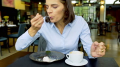 Businesswoman eating lunch and feeding someone, steadycam shot Stock Footage