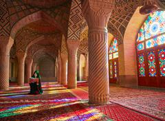 SHIRAZ, IRAN - March 01, 2016: Young Muslim woman praying in Nasir Al-Mulk Mo Stock Photos