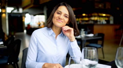 Businesswoman having a businesscall and smiling to the camera, steadycam shot Stock Footage