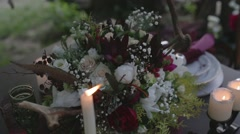 Burning candles and a bouquet of flowers Stock Footage