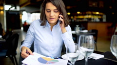 Businesswoman having a businesscall in the cafe, steadycam shot Stock Footage