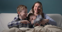 Mum and her two sons having fun in bed Stock Footage