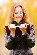 Beautiful girl in autumn - stock photo