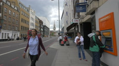 Carrying suitcases on Borough High Street in London - stock footage