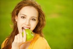 Girl with green apple Stock Photos