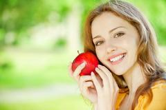 beautiful girl with red apple - stock photo
