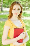 girl-student with a book - stock photo