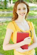 Girl-student with a book Stock Photos