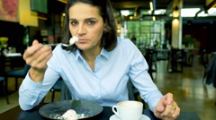 Businesswoman eating lunch and want to feed someone, steadycam shot Stock Footage