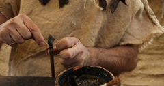 making a neolithic arrow - stock footage