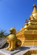 Golden pagoda in Kuthodaw temple in Mandalay - stock photo