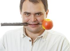 Man with knife and an apple - stock photo