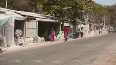 Street of Mandalay city in Myanmar with marble artisan works around Stock Footage