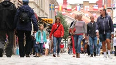 People walk by the street of the historical part of Gothenburg, Sweden. - stock footage
