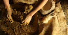 Close-up of hands kneading the mud Stock Footage