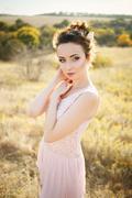 Beautiful Bridesmaid in rose quartz colored dress - stock photo