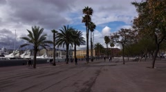 Seaside promenade against Port Vell, cool weather, leaden clouds over sky - stock footage