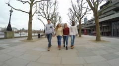Multiracial group of friends walking in London Stock Footage