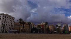 Leaden clouds over Barri de la Barceloneta houses, waterfront facades - stock footage