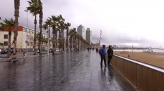 POV walk along empty seaside promenade, cold keen wind at Barcelona beach Stock Footage
