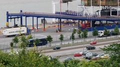 Cars pass by the road next to the port in Gothenburg, Sweden. Stock Footage
