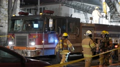 4K Firefighters Crew at Fire Scene - Nightime - stock footage