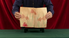 Magician Creates Fish From Paper - stock footage