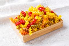 Gluten free corn and vegetable pasta spirals macaroni - stock photo