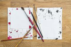 Blots of ink with different brushes on a white paper Kuvituskuvat