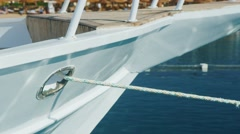 A white boat on the dock, a rope stretches to the anchor Stock Footage