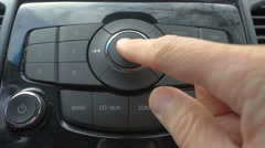 Man using car audio stereo system Stock Footage