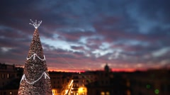 Big Christmas tree in Trinità dei Monti at sunset, orange sky. Rome. Stock Footage