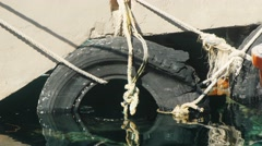 Old tire in the water Stock Footage