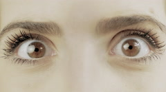 Extreme closeup of brown female eyes wondering looking left and right 4K Stock Footage